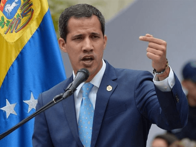 Venezuela: Guaido Struggles to Jump Fence to His Office as Maduro Mob Holds Him Back