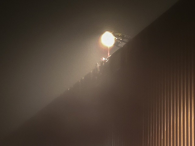 PHOTOS: Migrants Stranded on 30-Foot Border Wall in California