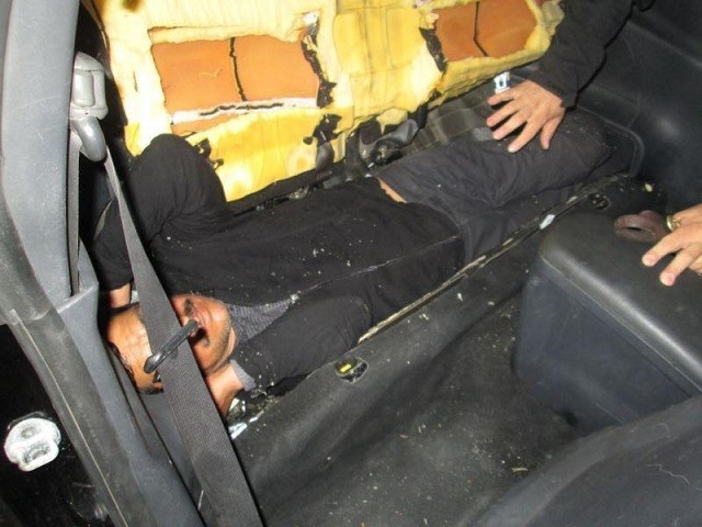 PHOTOS: Human Smugglers Hide Migrant Inside Rear Car Seat