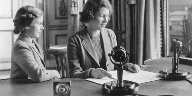 Princess Elizabeth makes her first broadcast, accompanied by her younger sister Princess Margaret Rose October 12, 1940, in London.