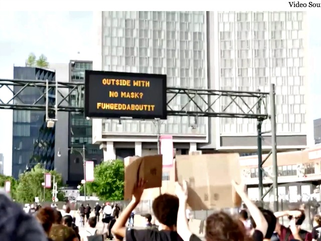 Watch: Over 1,000 Protesters March Underneath Digital Sign 'Outside with No Mask? Fuhgeddaboutit'