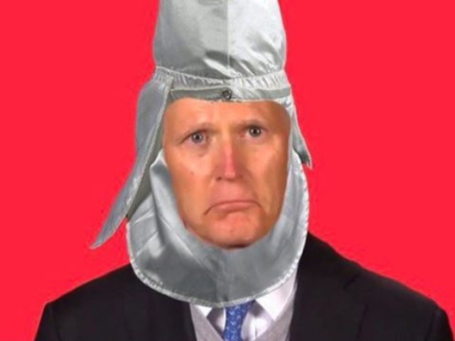 Sen. Rick Scott Portrayed as KKK member by Visa-Worker Group