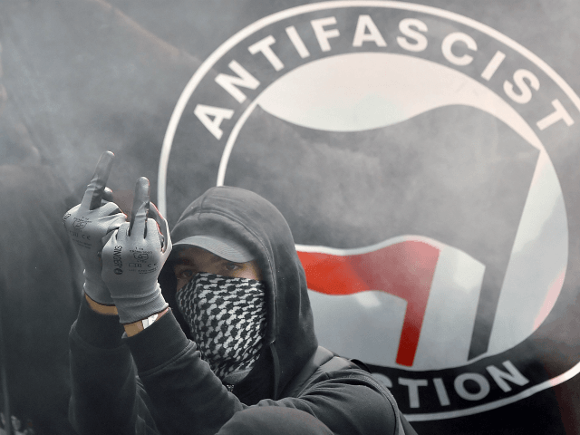 Facebook Removes Antifa and QAnon Groups