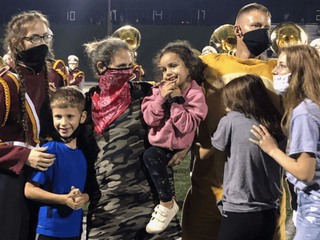 WATCH - Soldier Returns from Kuwait, Surprises Family at Football Game: 'We Needed This'
