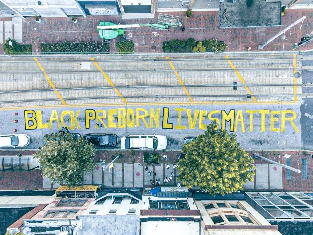Students for Life Paint 'Black Preborn Lives Matter' on Baltimore Street