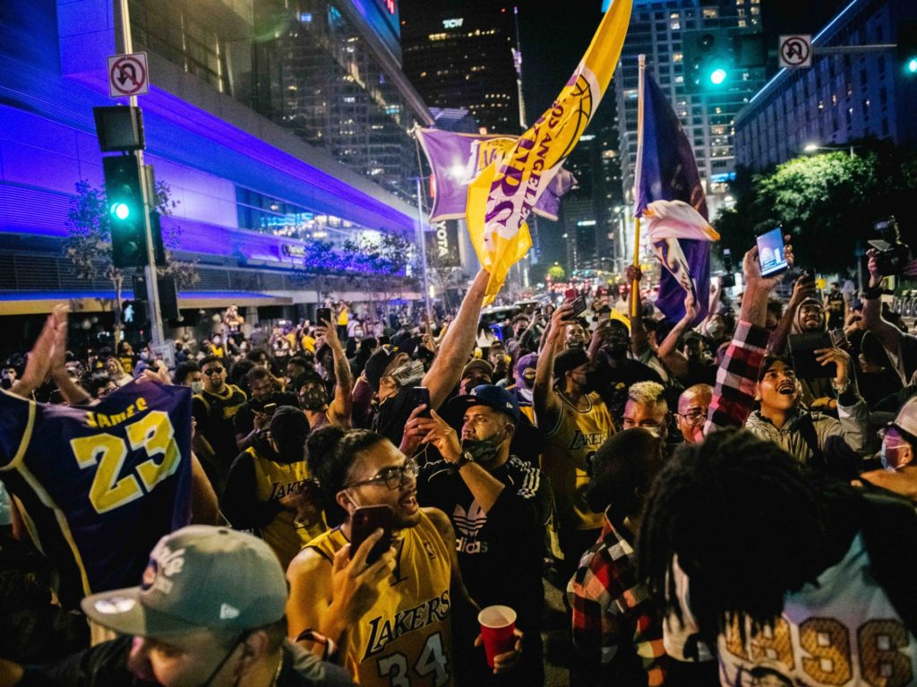 WATCH: 'Mostly Peaceful' Lakers Fans Party Outside Staples Center; Few Masks, LAPD Car Attacked