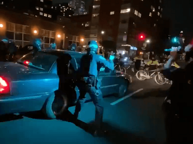 Watch: Car Drives into Line of NYPD Cops During Protest, At Least One Officer Wounded