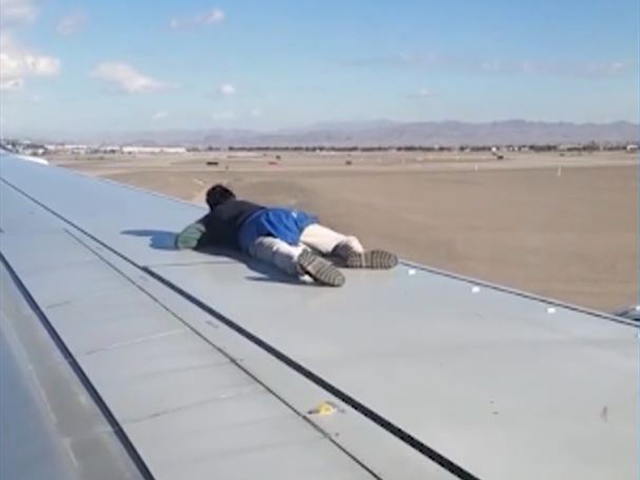 VIDEO: Man in Custody After Climbing Aircraft Wing