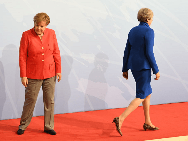 Merkel 'Mocked' PM May's Brexit Negotiations at Secret Davos Briefing