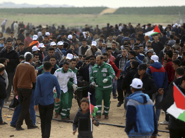 Pictures: Violent Clashes as Thousands of Gazans March Near Israel Border
