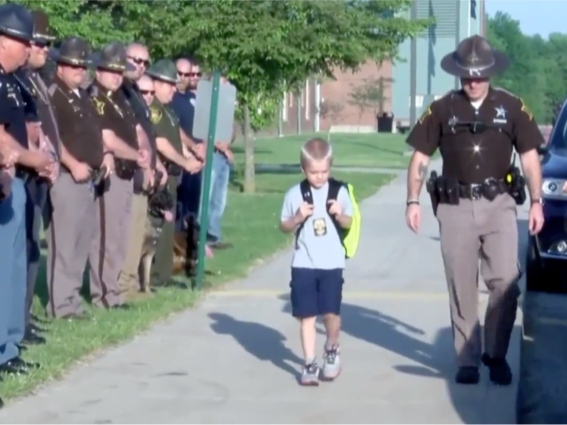 70 officers greet 5-year-old son of fallen cop on his first day of school after tragedy