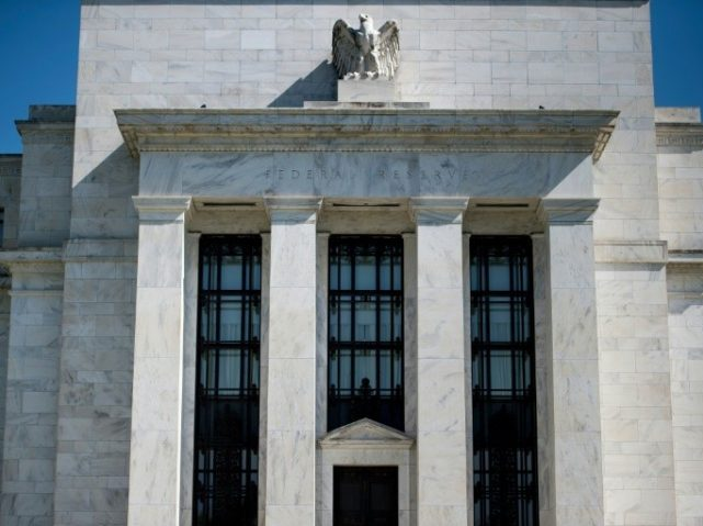 Fed Raises Interest Rates, Predicts Two More in 2018, Sees Economy Growing Faster