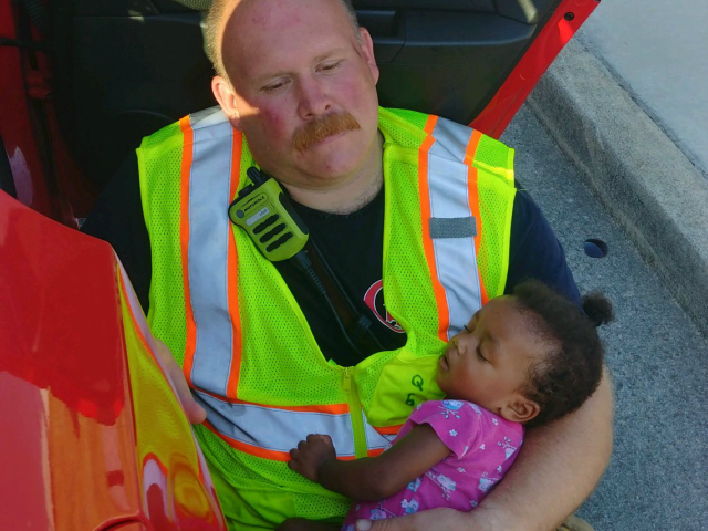 Firefighter Cradles 4-Month-Old Girl After Car Accident