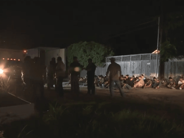 WATCH: Texas Cops Find 55 Migrants, Children Smuggled in Tractor-Trailer