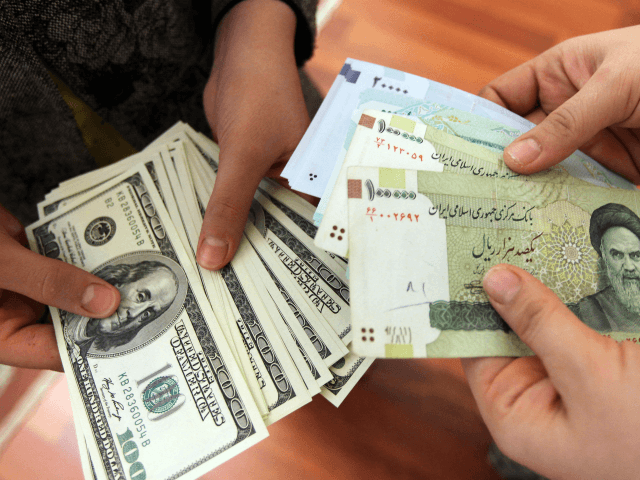 Currency Crash: Iran's Rial Hits Record-Low of 100,000 to the Dollar