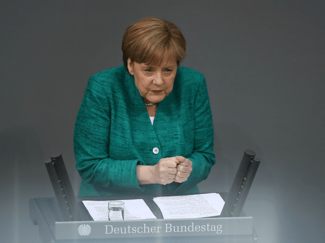 Teetering Merkel Concedes Some Migration Controls to Stave Off Political Demise