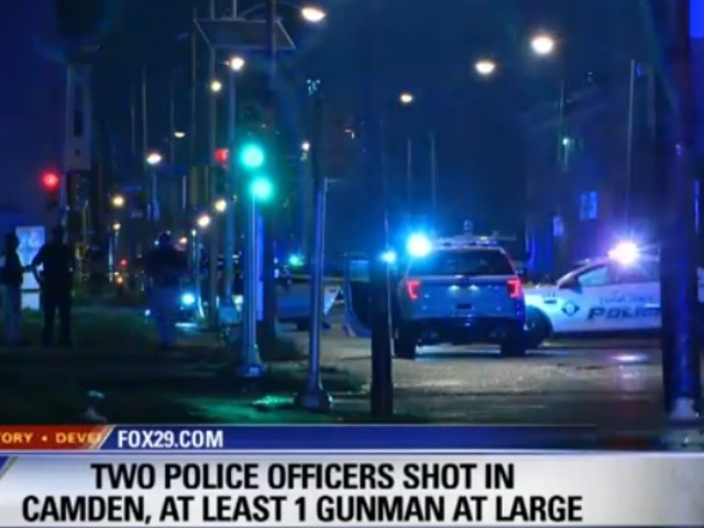 Two Officers Ambushed, Shot While Stopping for Red Light