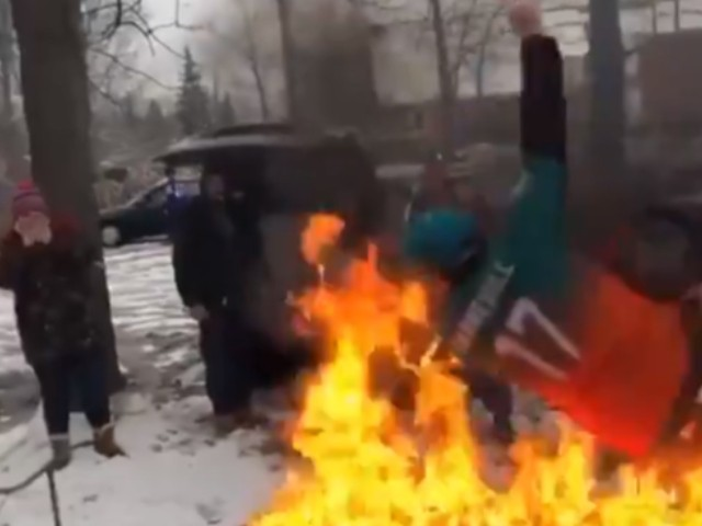 WATCH: Dolphins Fan Consents to Being Thrown On a Table of Fire