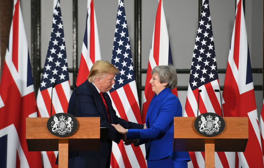 UK PM May Hails Trump for Strengthening NATO Alliance
