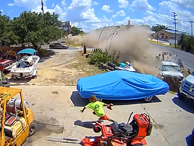 VIDEO: Driver Veers Off Road, Plows into Parked Truck