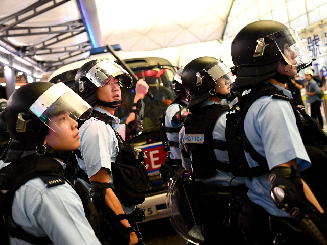 Riot Police Storm Hong Kong Airport as Protesters Tie Up Suspected Undercover Communists