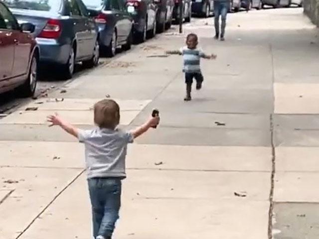 VIDEO: Toddlers Run Towards Each Other, Hug on NYC Street