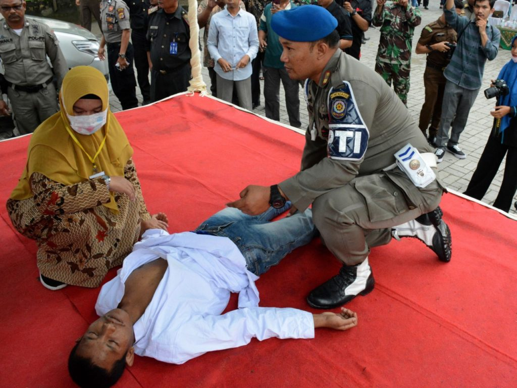 Pics: Indonesian Man Faints During Flogging for Sharia-Banned Sex, Is Revived and Whipped Again